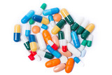 colored pills and capsule on white background