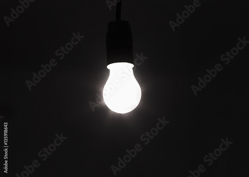light bulb shines a bright light, soft focus Poster
