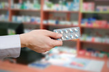 Pharmacist holding tablets in hands