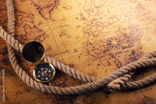 Staande foto Schip time for adventures - vintage compass and rope on old world map