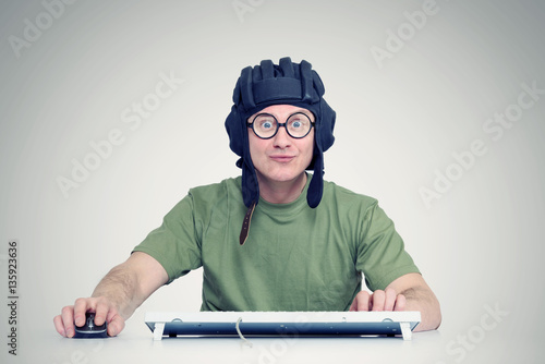 Man playing a computer game in the helmet tanker Poster