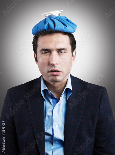 Poster Office worker with an ice pack on his head