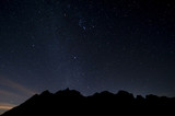 Stars on the night sky above the mountains.