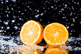 fresh orange with water splash on black background