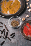 Cardamom, chilli, curry dishes on the slate partial blur