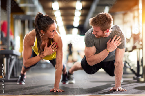 Man and woman strengthen hands