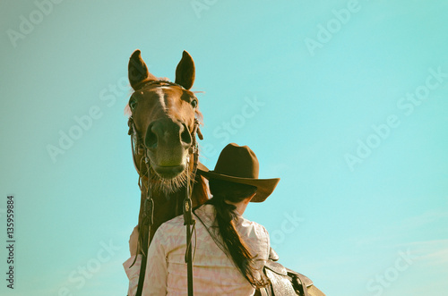 Vintage equestrian background with horse and cowgirl.  Western and rustic graphic resource appeal.