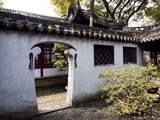 White walled courtyard in Yuyuan traditional Chinese garden
