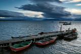 Boats at the pier and ships at sea. Puerto Natales. Chile.