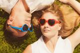 Man and woman wearing heart shape sunglasses