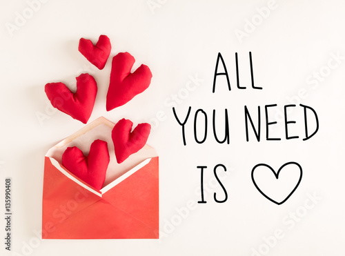 Poster All You Need Is Love  message with red heart cushions