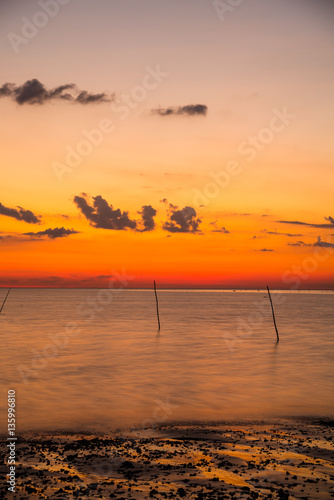 Poster Oranje eclat Beautiful sky with sunset at the beach