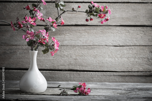 pink apple flowers on old wooden background