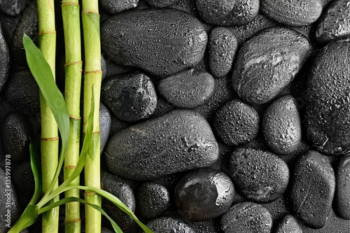 zen basalt stones and bamboo leaves