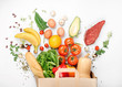 Full paper bag of different health food on white background - 135999033