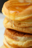 Close-up of a stack of pancakes with honey.