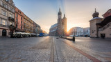 Panorama of Krakow architectural ensemble, sunrise over the old town Market square with St. Mary's church (Mariacki cathedral), Cloth Hall (Sukiennice) and colorful buildings, Poland, Europe