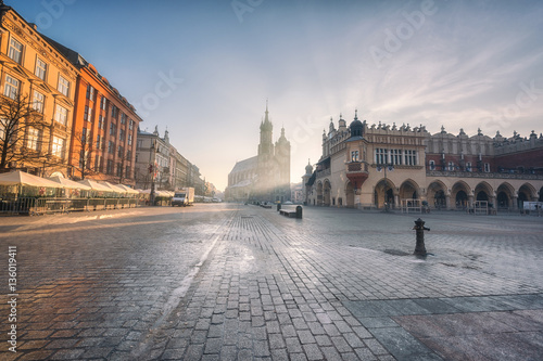 Krakow old town, Market square, St. Mary's church (Mariacki cathedral) and Cloth Hall at sunrise, wide-angle view cityscape, Poland, Europe
