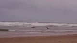 Surfboarders enjoying the waves on irish waters in the Republic of Ireland