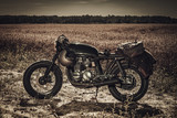Vintage custom motorcycles in field