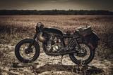 Vintage custom motorcycles in field