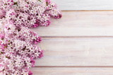 Purple lilac flowers on wooden table - 136062293