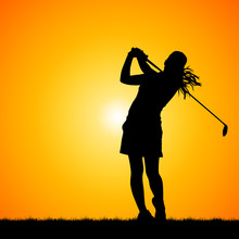 silhouettes golfers against sunset background