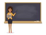 Fototapety African teacher teaching in classroom