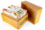 Vintage wooden recipe box with handwritten cards - 136073400