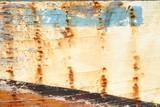 Hintergrund verwitterte lackierte Planken eines Schiffswracks