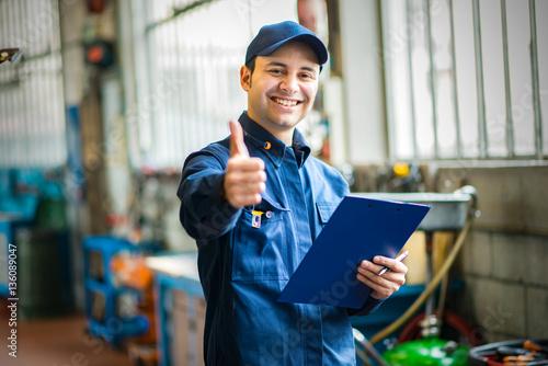 Smiling mechanic thumbs up