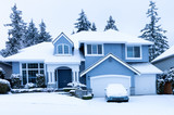 Front view of home during winter snowfall