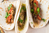 Mexican food. Slow cooked pork carnitas with salsa verde