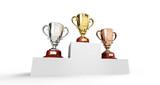 Podio con 3 copas de oro, plata y bronce.