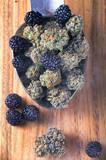 Cannabis buds (Berry Noir strain) with fresh fruit - medical mar