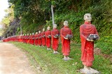 Buddhist monks statues row