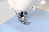 Sewing machine blue fabric, white background