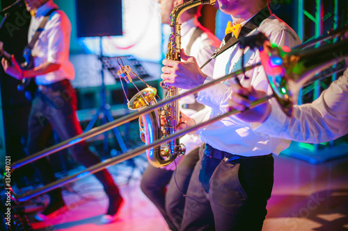 Poster musician plays the saxophone performance at a concert