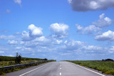 Asphalt road over blue sky background.