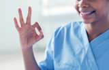 close up of african medic or nurse showing ok sign