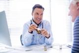 Doctor explaining medicine to senior patient