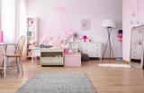 Spacious girl bedroom in pink