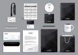 Corporate identity design template with gray black polygonal background