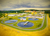 Aerial view of public sewage treatment plant for 165, 000 inhabitants of Pilsen city in Czech Republic, Europe. Environment and industry from above. - 136235066