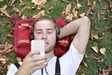 Blonde guy chilling on the grass