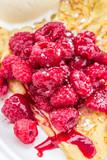raspberry desert with ice cream on a crepe
