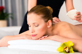Woman having wellness massage in spa with oil