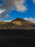 Wide view of Volcanic Landscape with Mountain in Distance