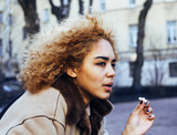 young pretty girl teenage outside smoking cigarette close up, lo
