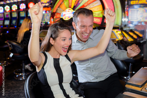 Couple celebrating casino victory Poster